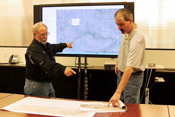 Two of SKW survey team reviews a proposed pipeline route
