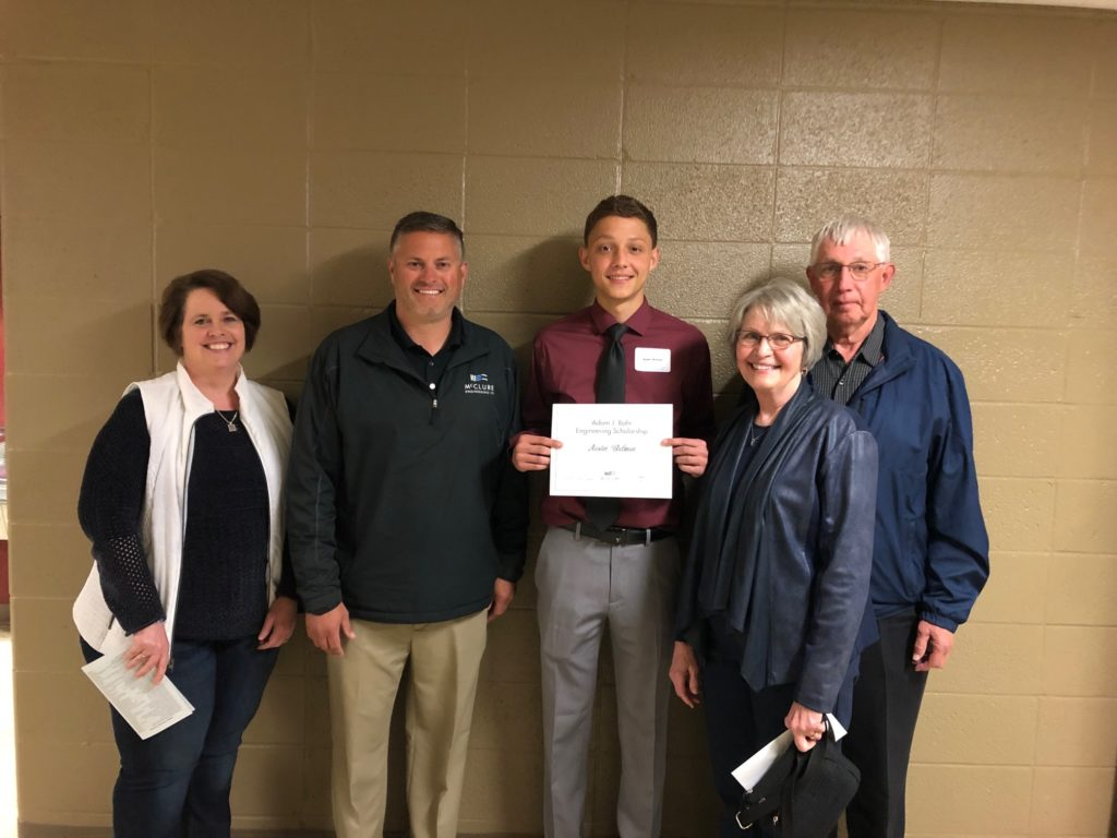 Austin Bulman presents his scholarship alongside his family.